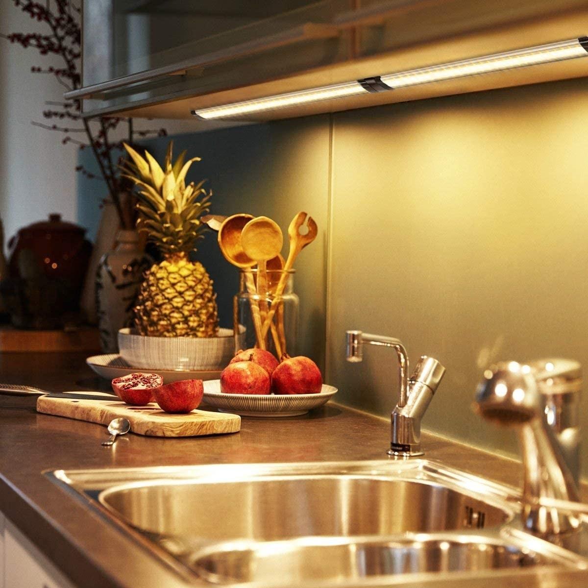Strip lights on cabinet brightening a kitchen counter top