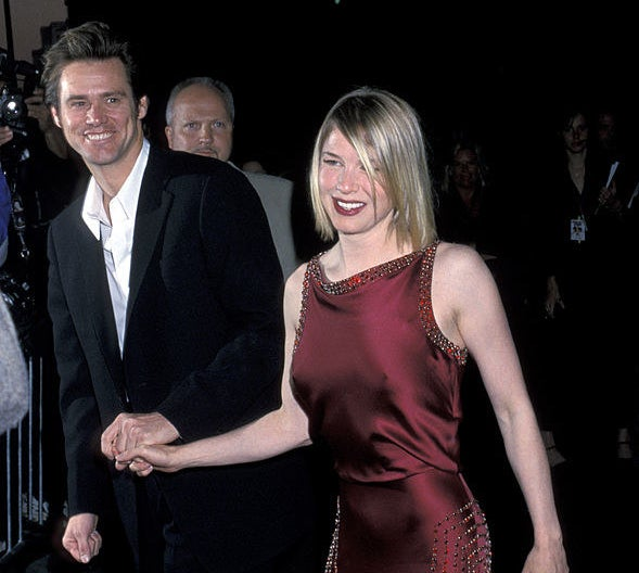 A red carpet photo of Jim Carrey and Renée Zellweger.