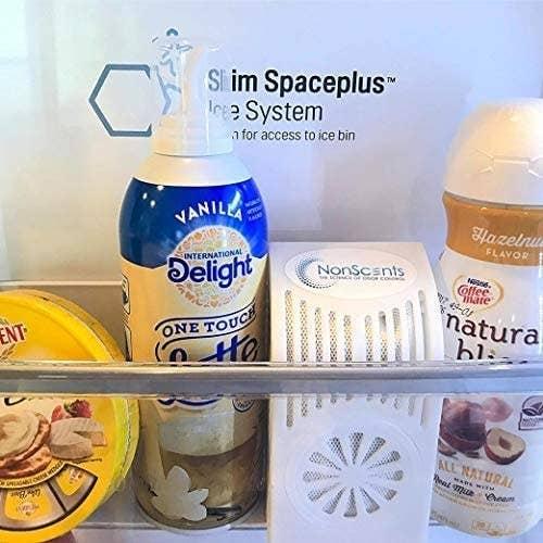 A white deodorizer on a fridge shelf