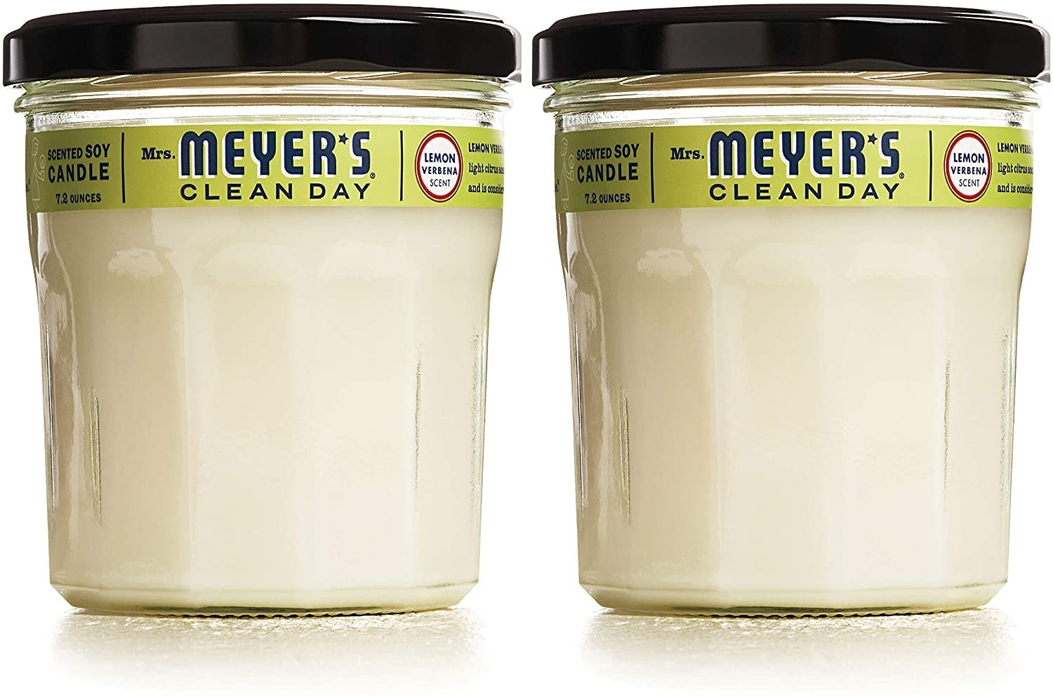 Two white Mrs. Meyer's Clean Day candles