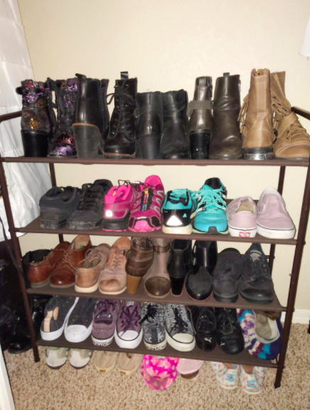 Reviewer's black four-tier shoe rack with boots and Vans sneakers