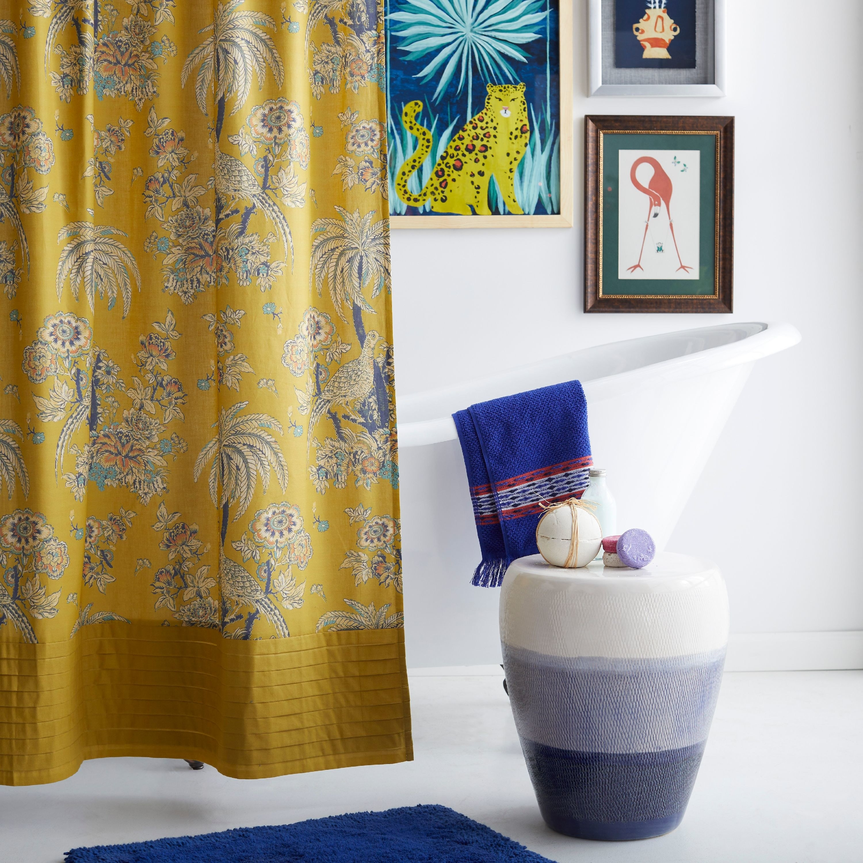 a yellow shower curtain with a floral design on it