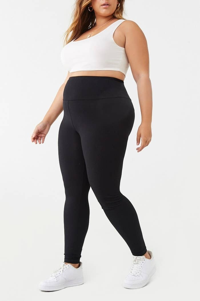 model wearing black high-rise leggings