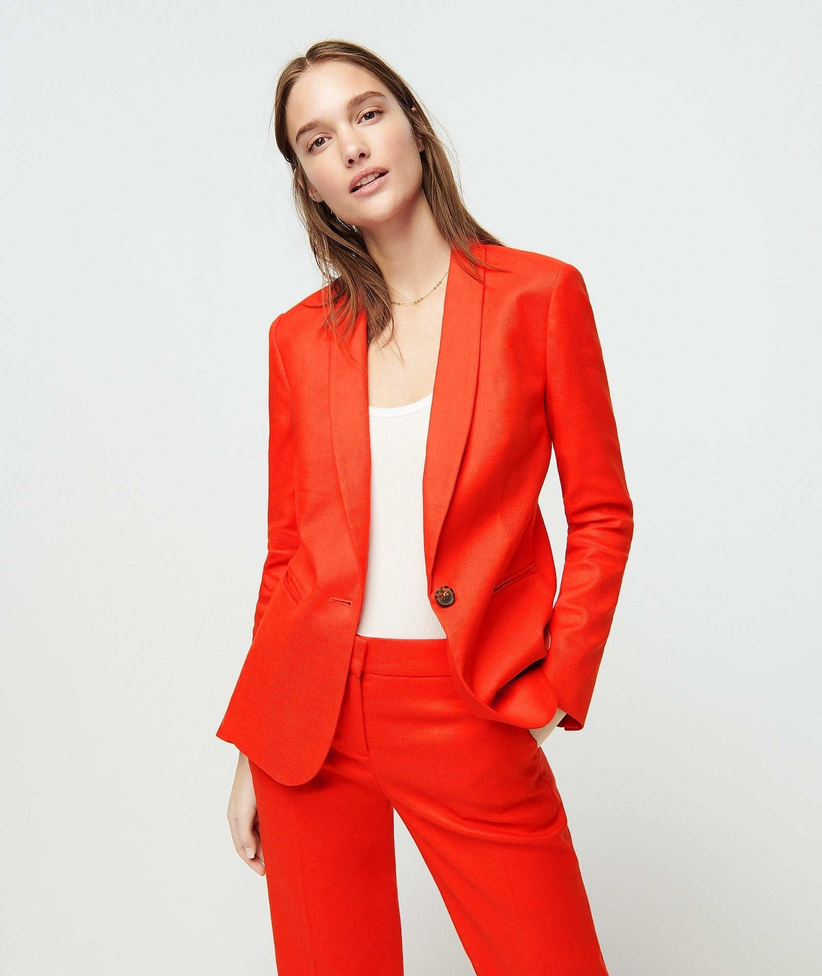 model in bright red single button blazer with matching pants
