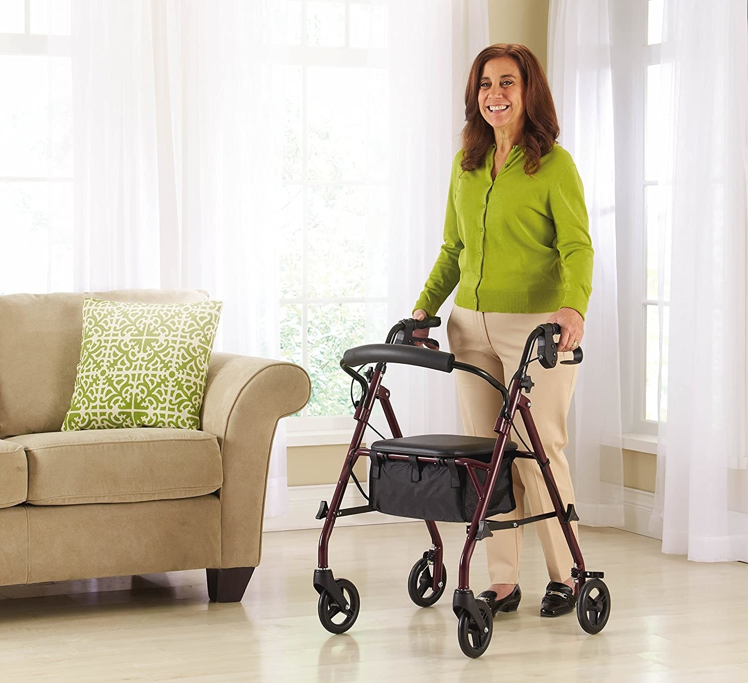 person using the walker to walk across a living room.