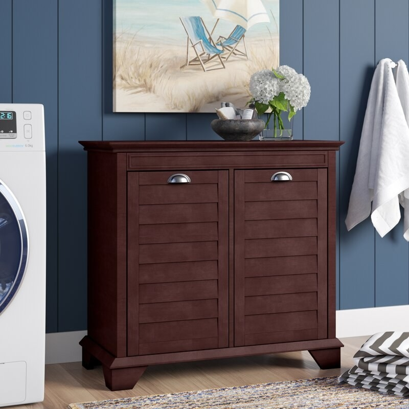 The hamper that looks like a dresser with two compartments that open up to collect clothes