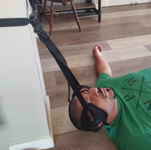 A customer review pic of a person using the neck and head hammock.