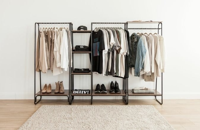 The brown and black rack pieced together with two additional racks and a small shelf