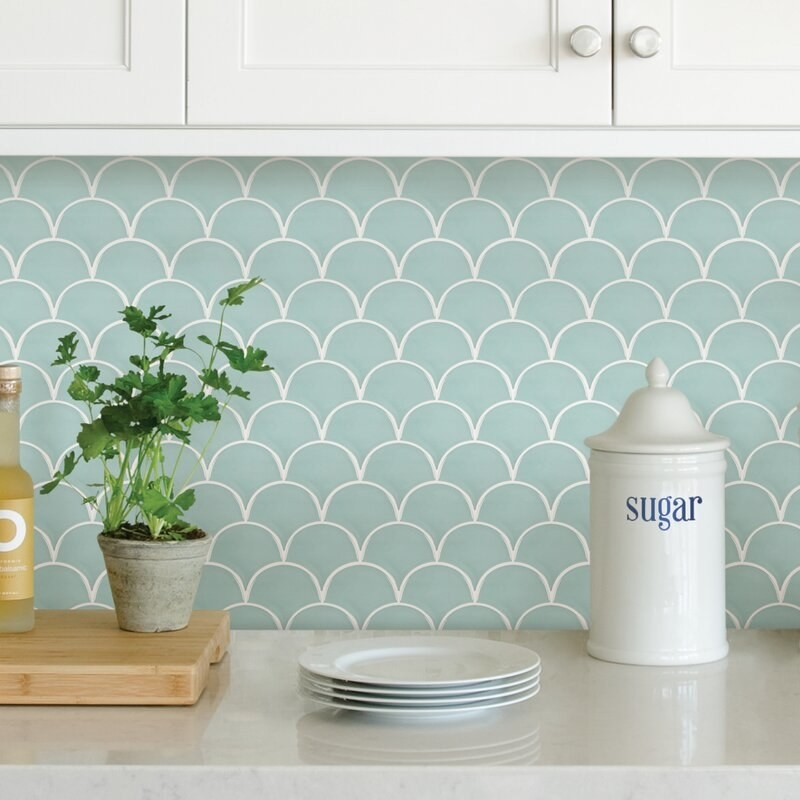 The light blue tile with a scalloped pattern outlined in white