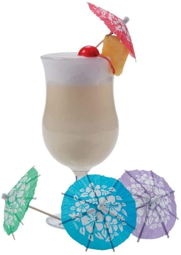 The umbrellas in red, green, blue, and purple around a tropical drink