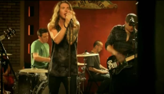 "A screengrab of from the Dirty Head performing ""Lay Me Down"" from their music video for it"