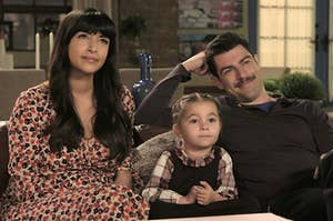 Cece and Schmidt from New Girl with their daughter Ruth