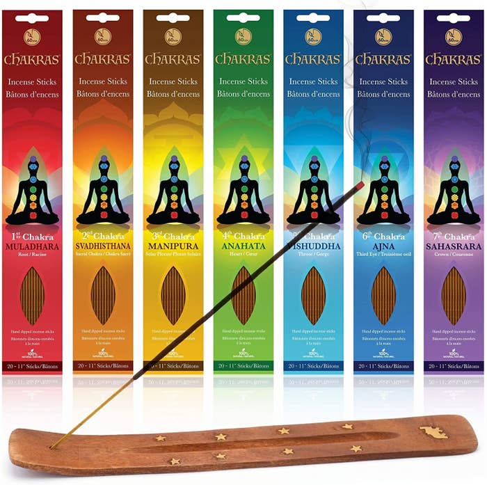 Seven packs of incense and a stick in an incense burner