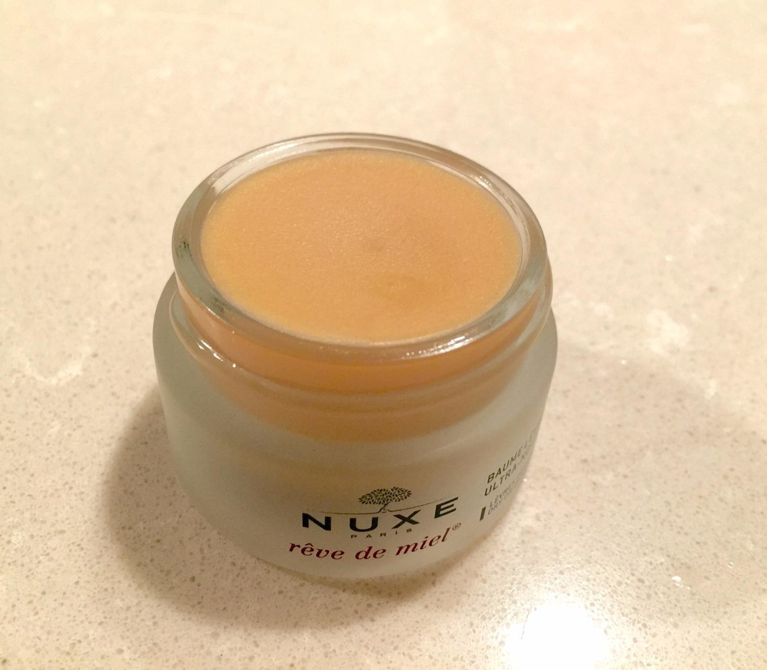Reviewer photo of the lip balm, which comes in a small pot