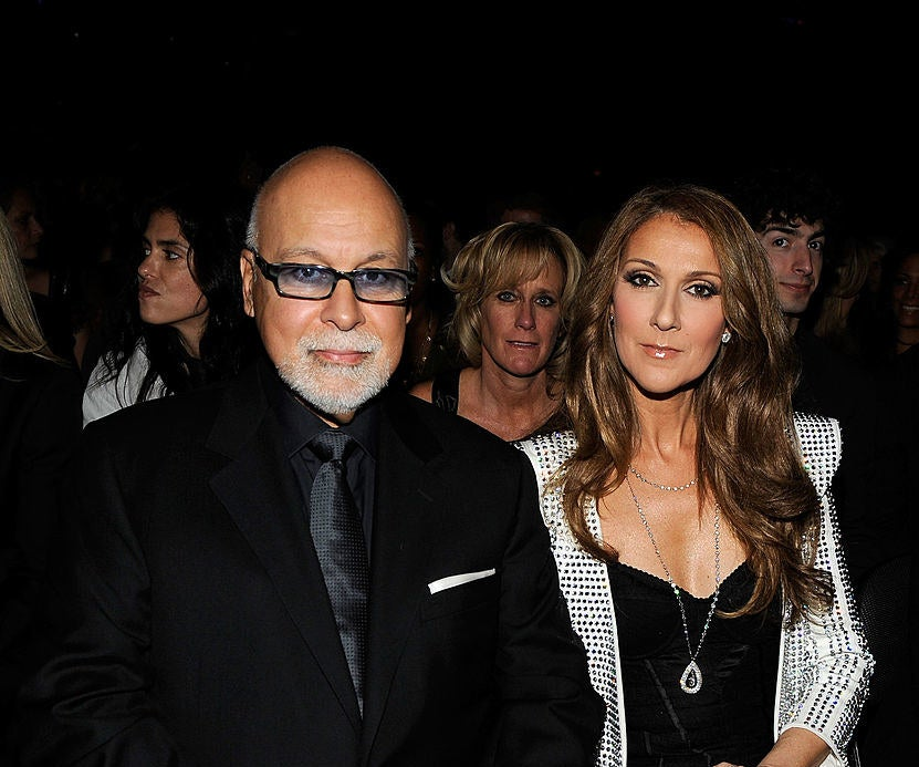 A close-up of. Rene Angelil and Celine Dion sitting in the audience of an event in 2010