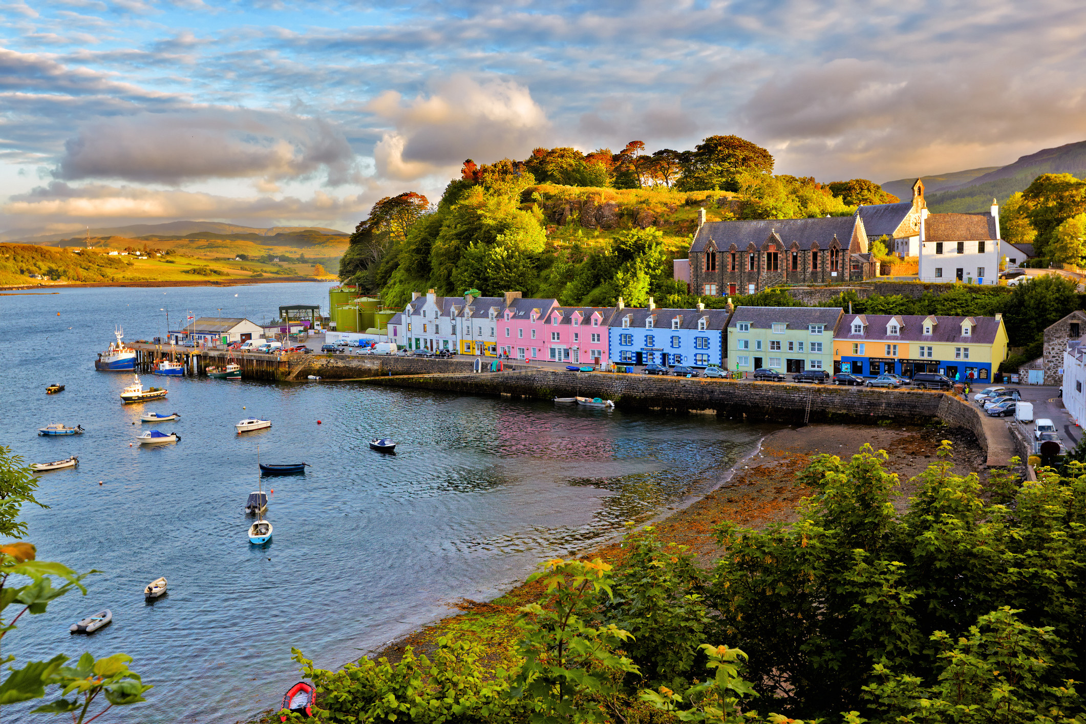 The bay of Portree with the village's colourful houses sat on the coast road