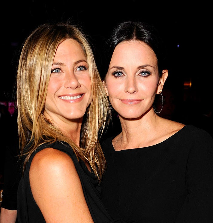 Photo of Jennifer Aniston hugging Courteney Cox at an event in 2010