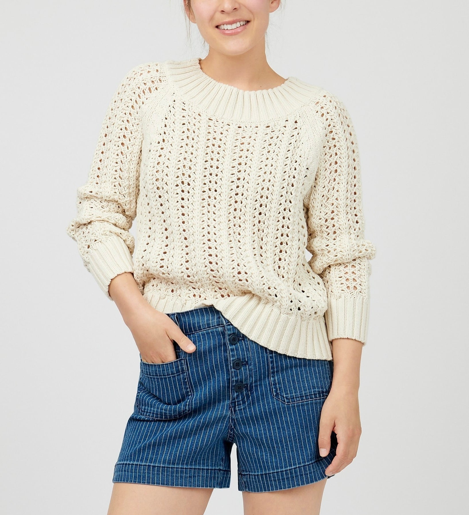 model in beige sweater with wide ribbed hem, neck, and cuffs