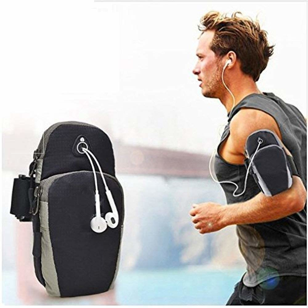 A man jogging with the pouch attached to his arm and earphones plugged in through it