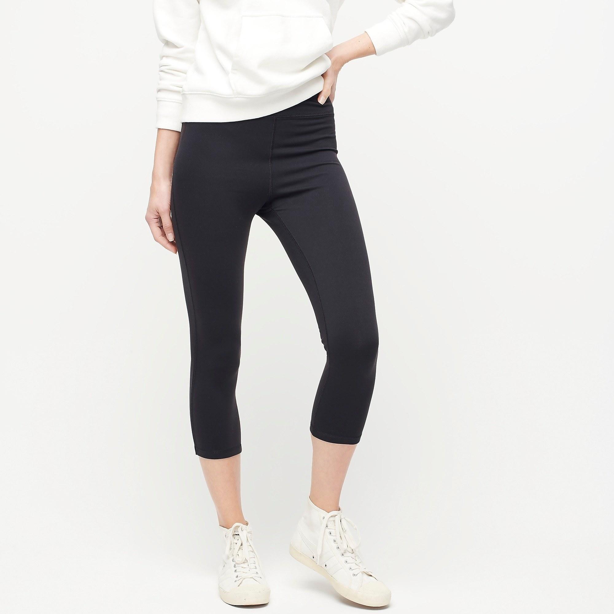 model in black cropped leggings