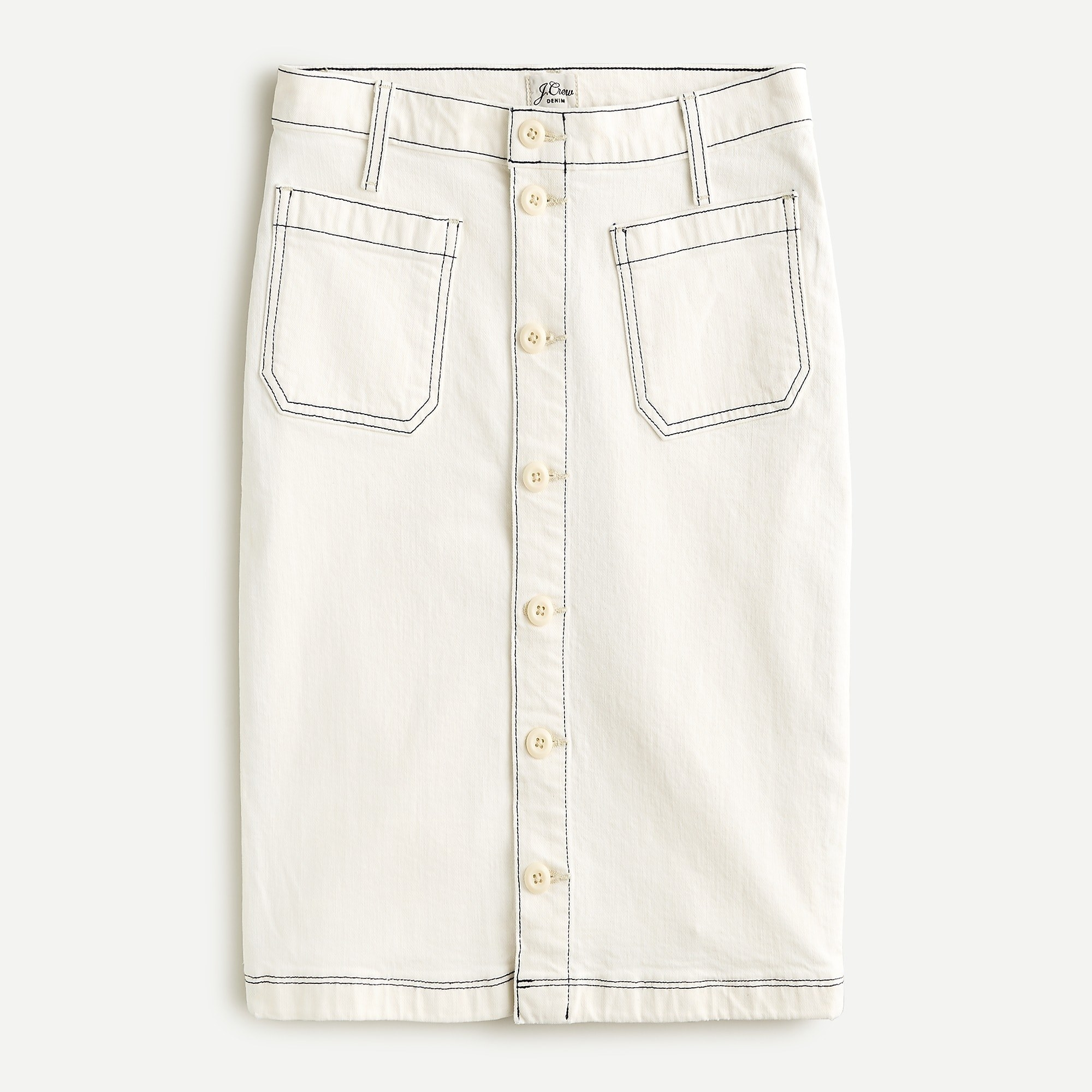 white denim knee length skirt with black stitching and white buttons down the front