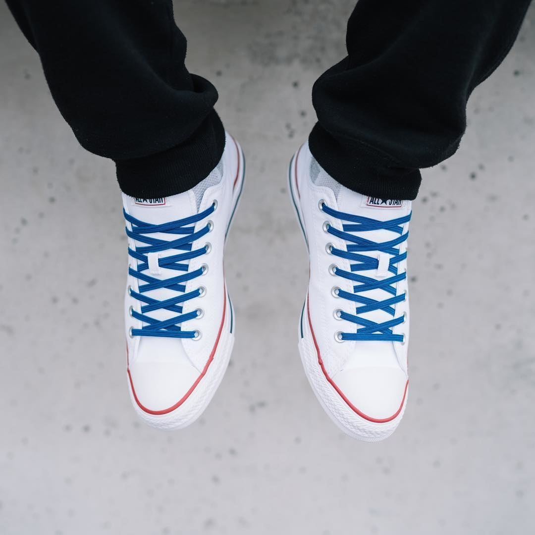 A pair of Converse with tie-free shoelaces in them