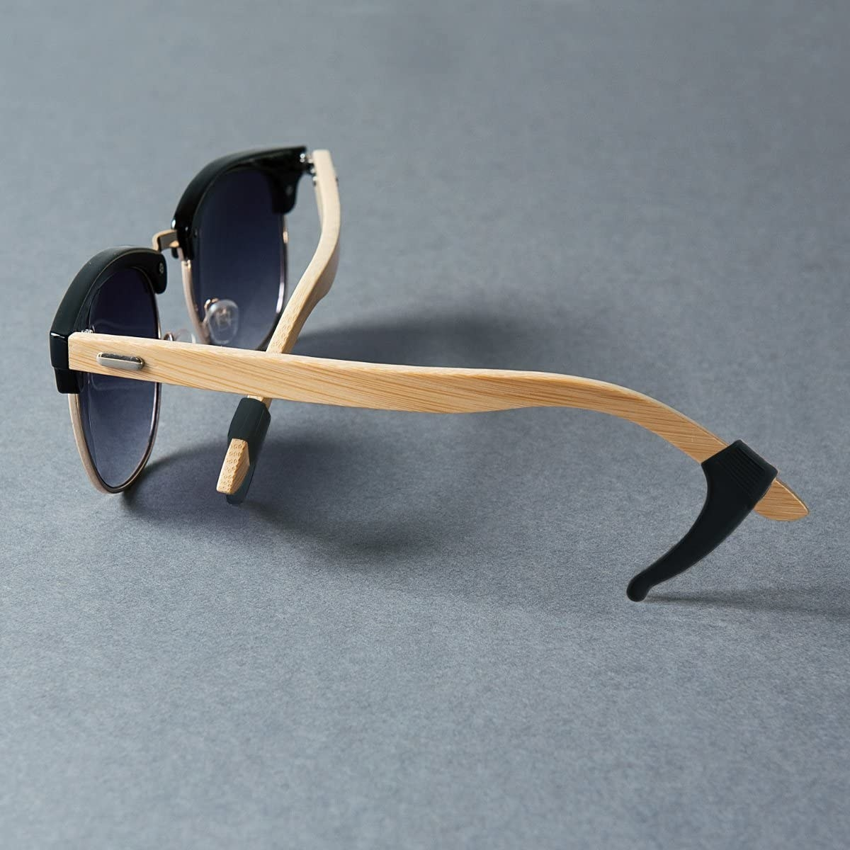 A pair of sunglasses with the silicone tips on their arms