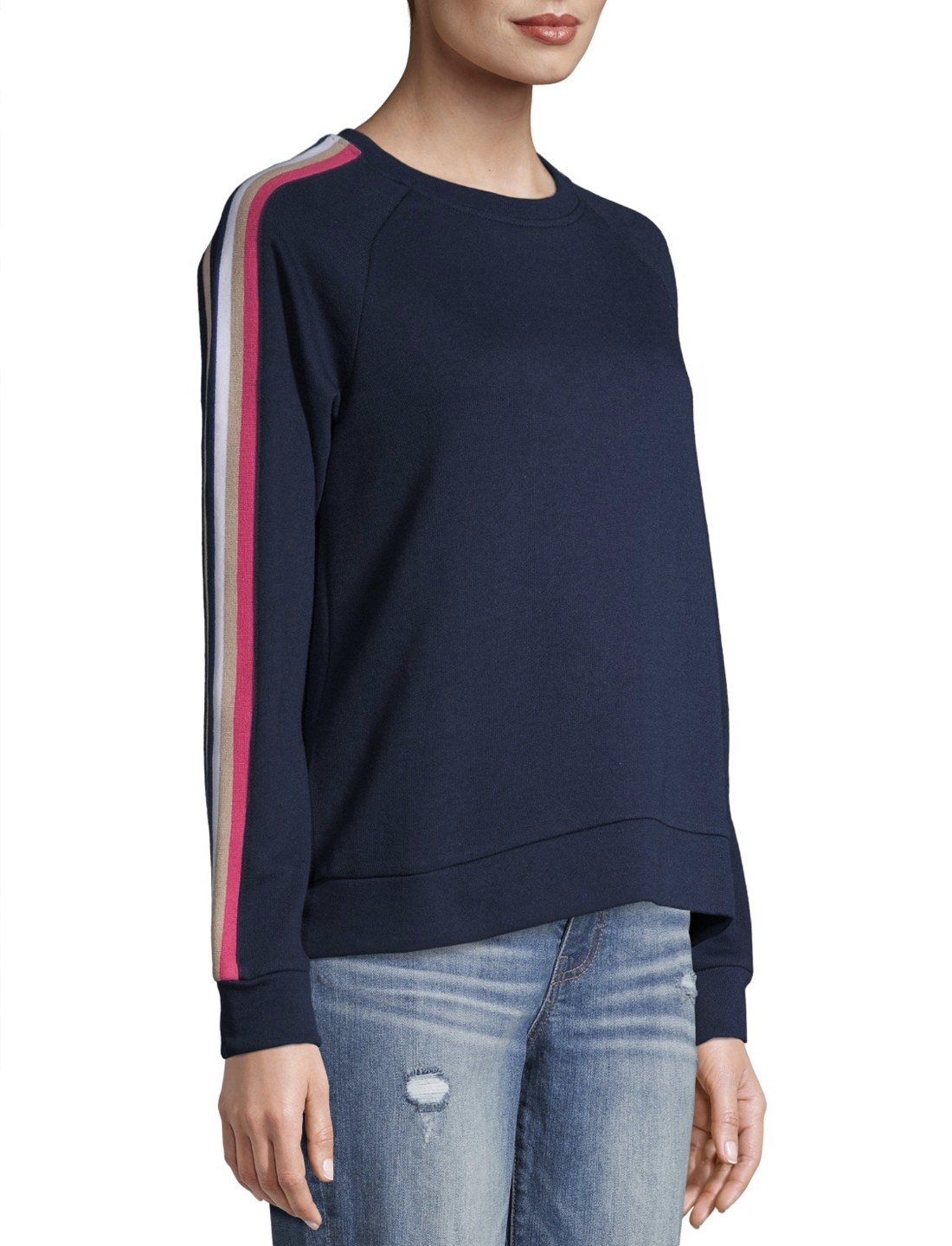 Model in navy blue sweatshirt with red sleeve stripes