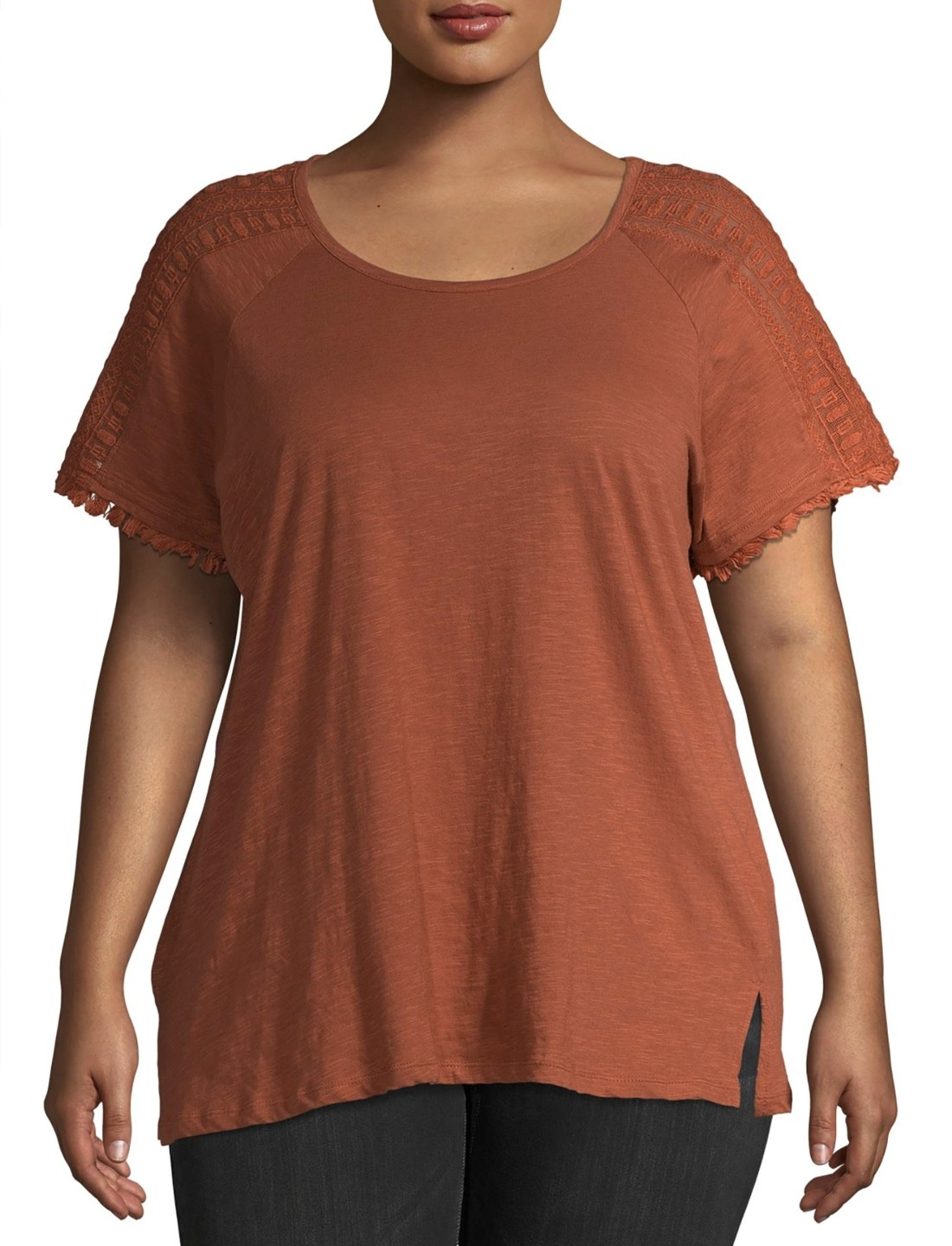 Model in the orange T-shirt with lace-trim sleeves