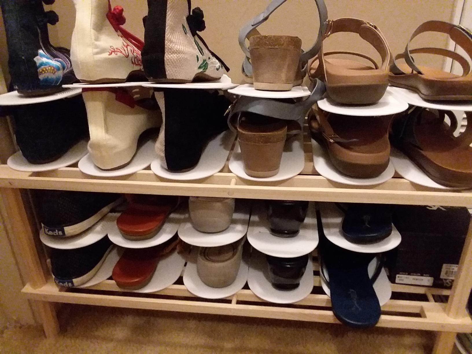 A reviewer photo showing 11 pairs of shoes fitting on a six-pair shoe rack, because the doublers allow each pair to stack on top of each other