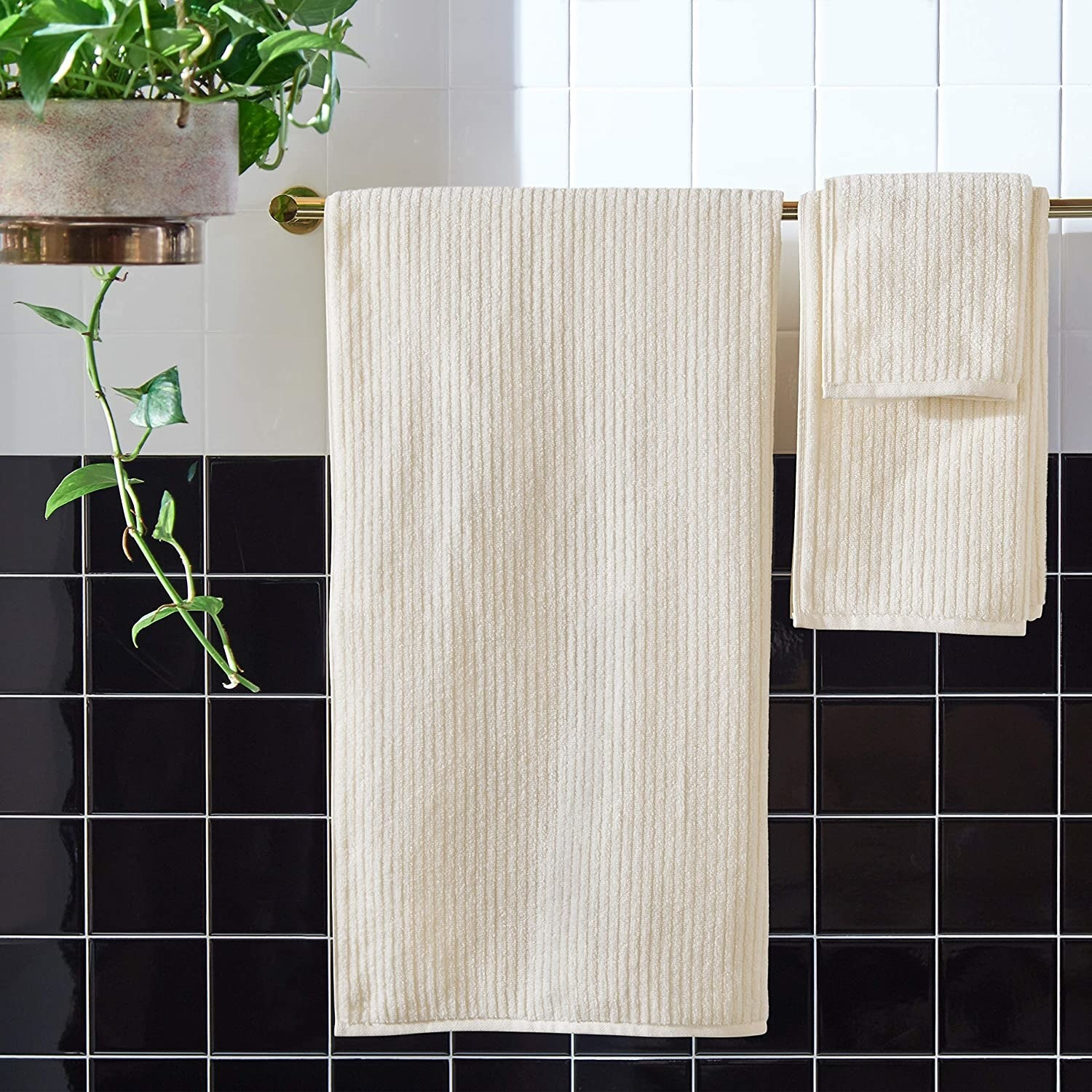 The set of towels neatly hung in a bathroom