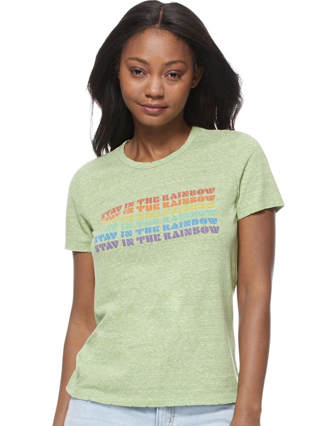 "Model in the light green T-shirt with ""stay in the rainbow"" written six times down the chest"