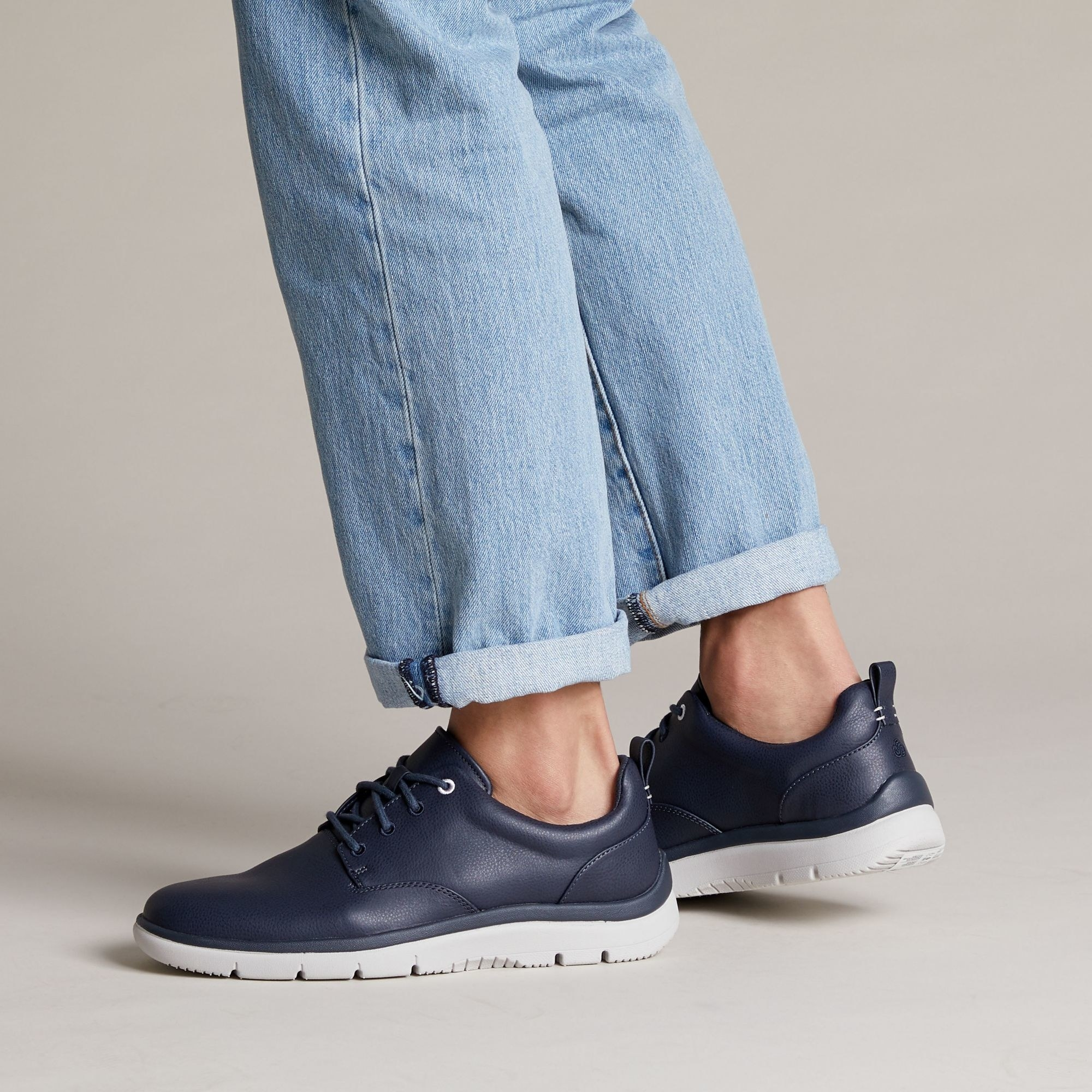 navy sneakers with white soles
