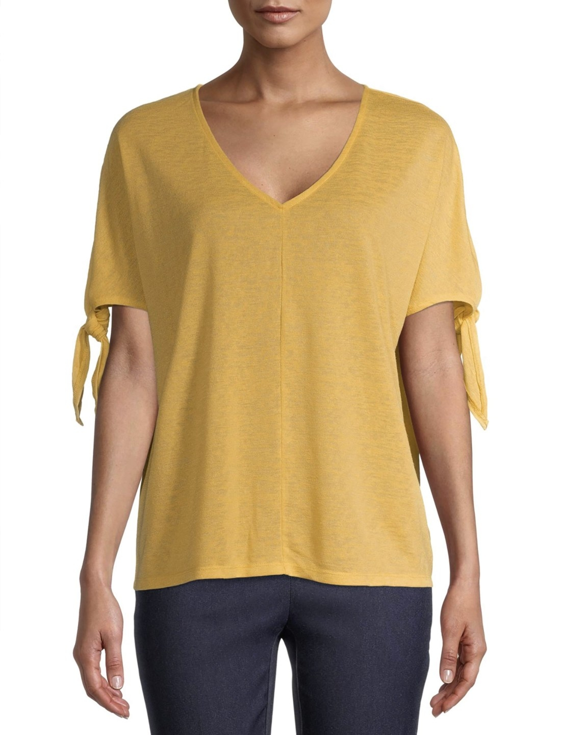 Model in the mustard yellow top