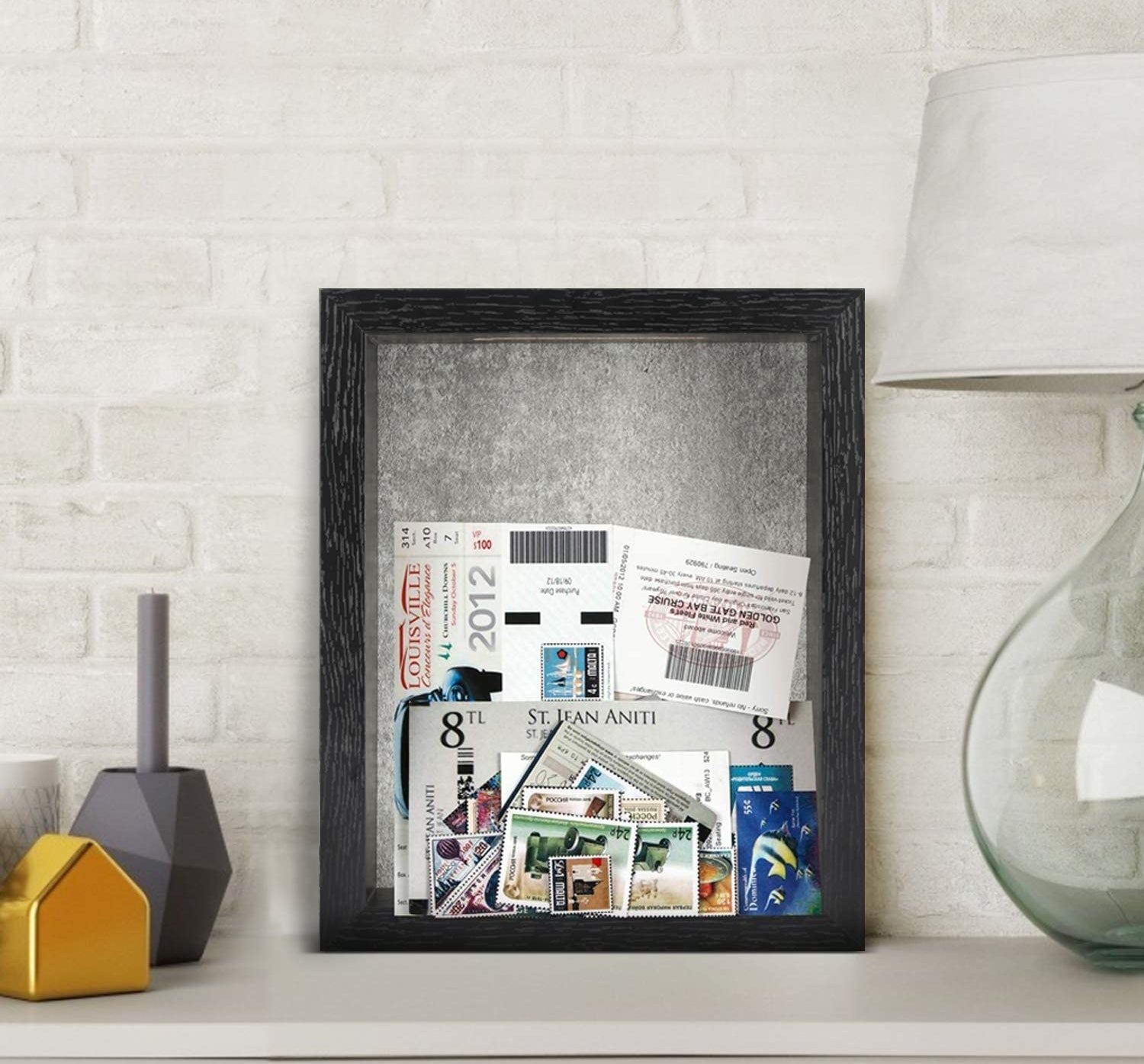 The shadow box perched on a sideboard and filled with ticket stubs and photographs