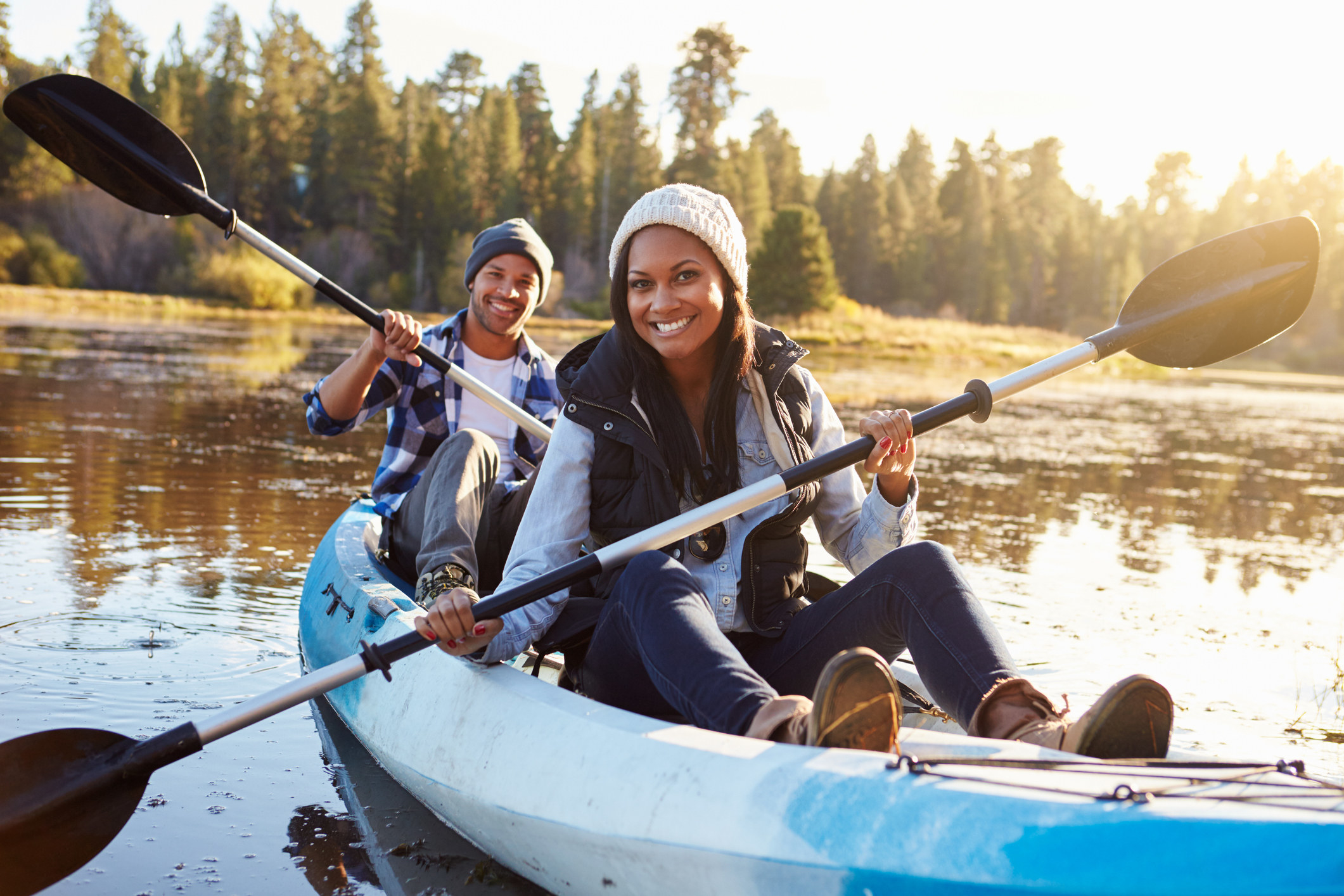 Smiling couple, man and woman, kayaking.