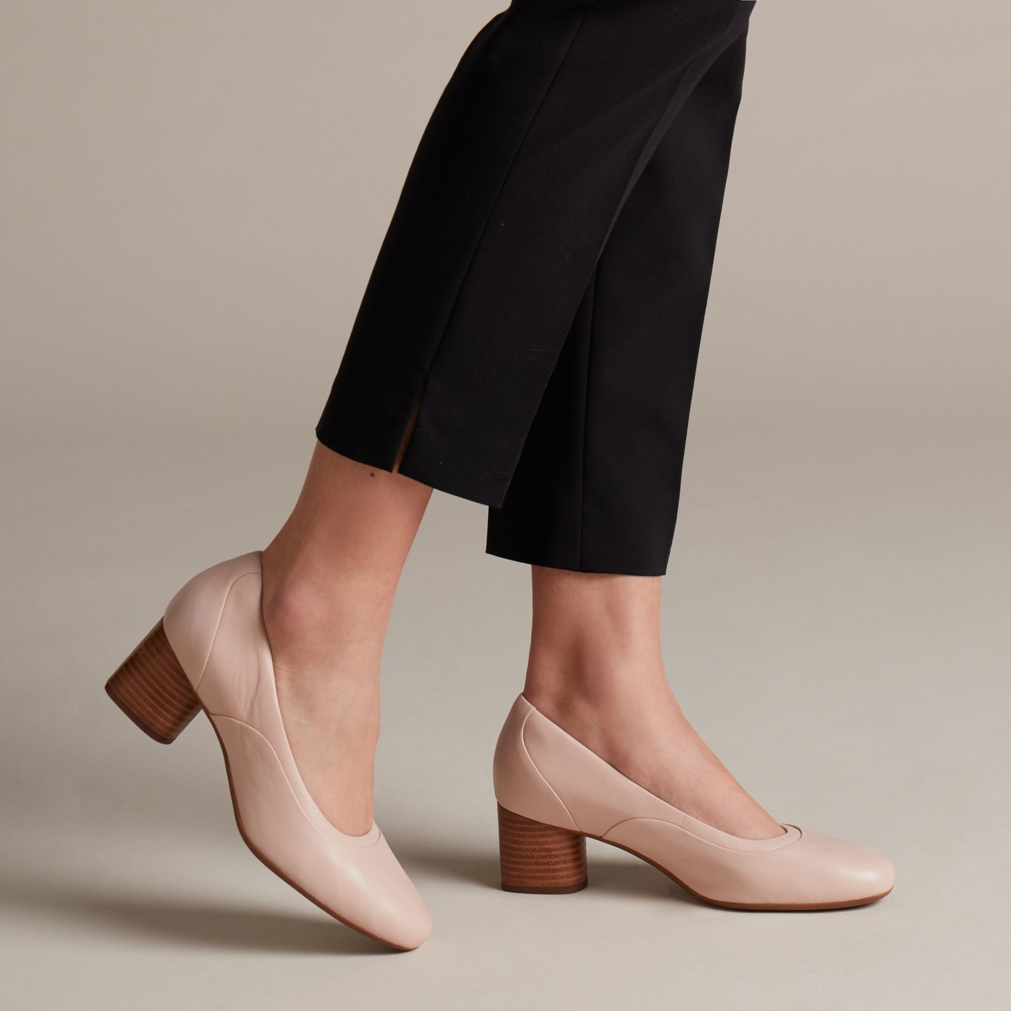 pink pumps with rounded wooden heels