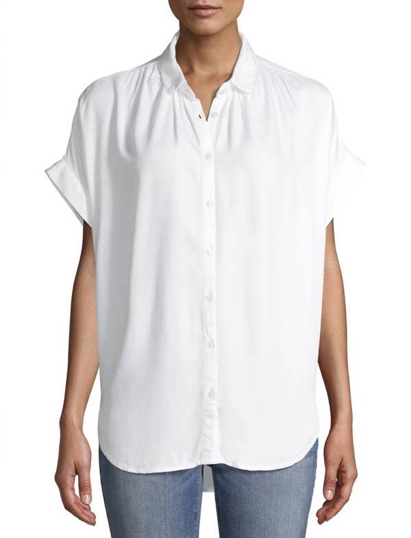 Model in the sleeveless white blouse