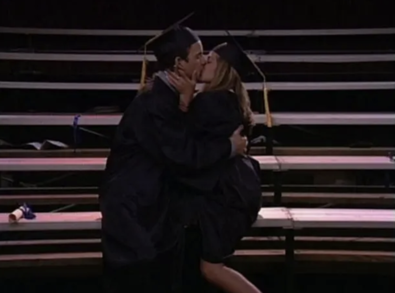 Topanga and Cory kissing in their graduation cap and gown