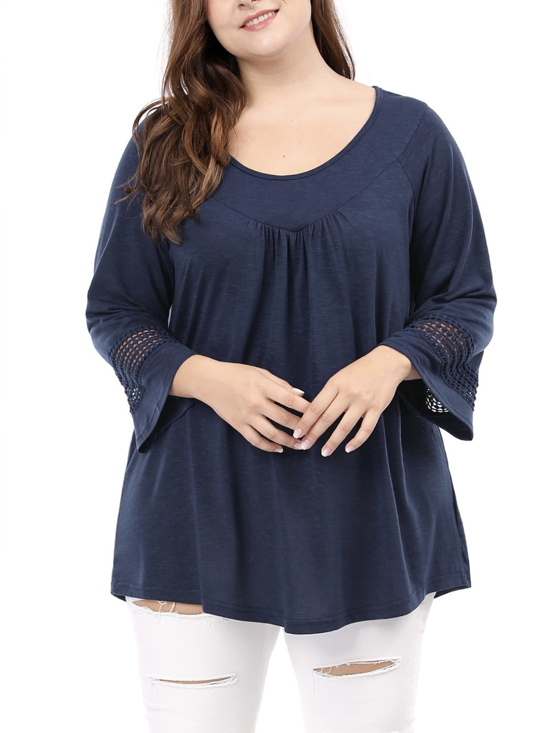 Model in the navy blue long sleeve top with lace sleeve trim
