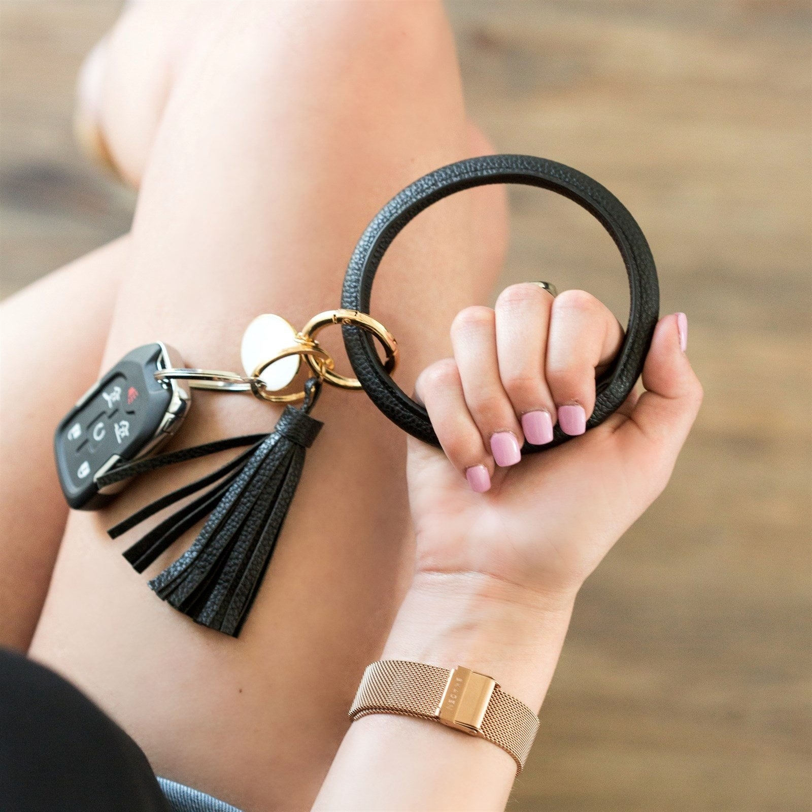 A person holding the keyring bangle