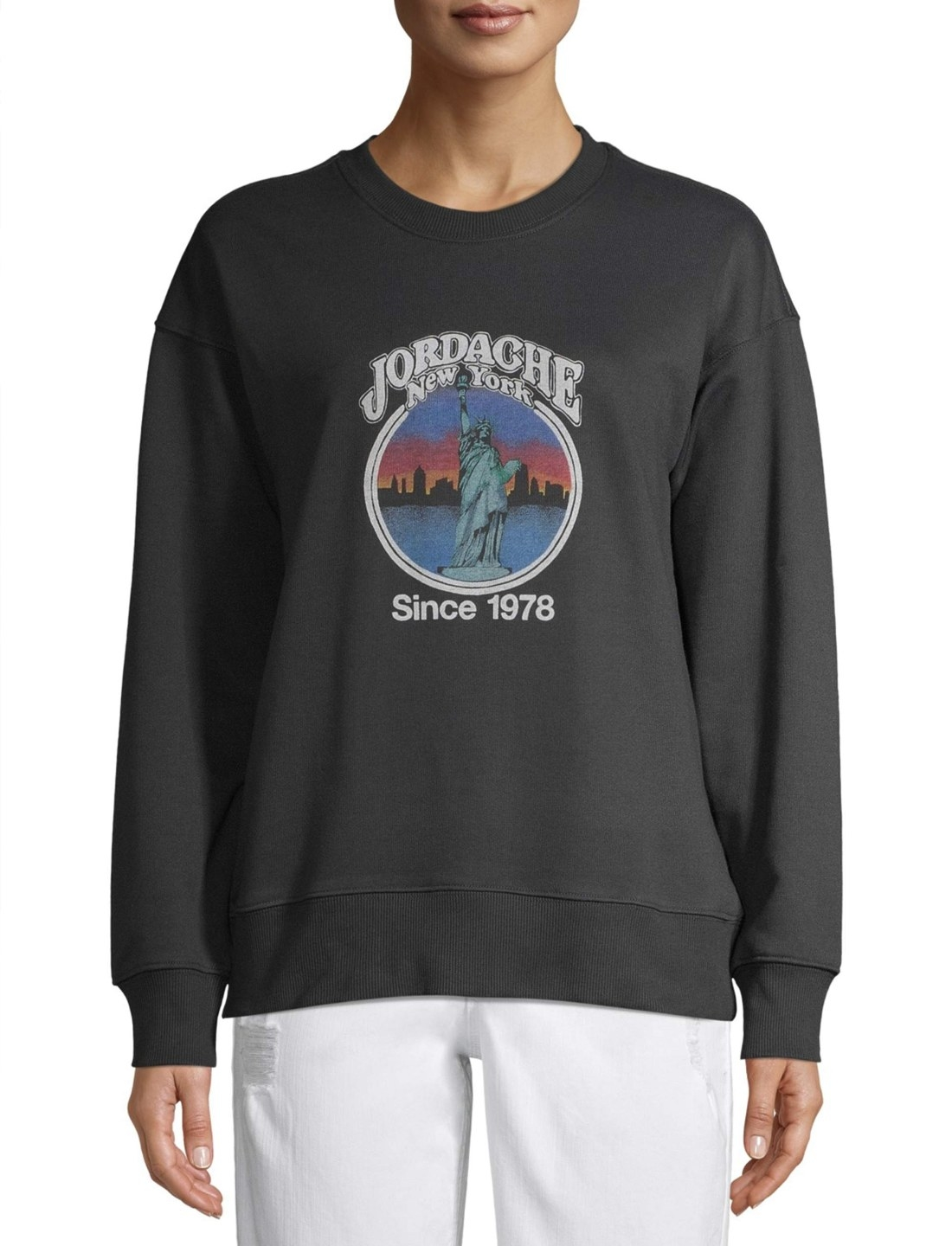 "Model in the black sweatshirt with the words ""Jordache New York: Since 1978"" surrounding the Statue of Liberty"