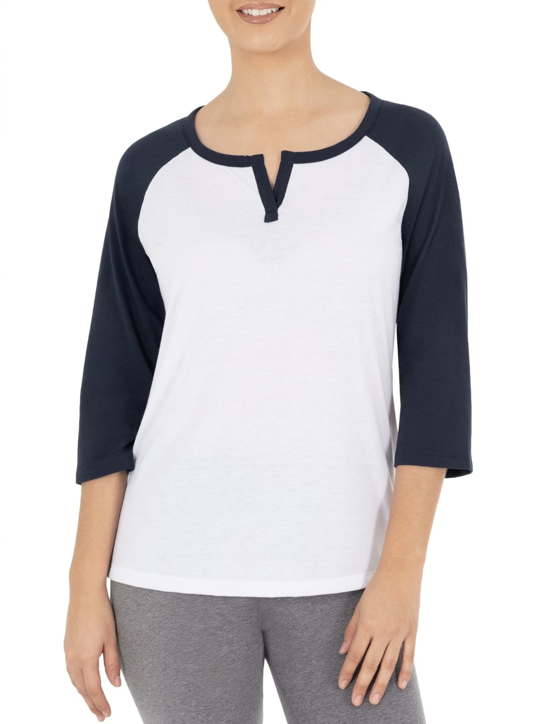 Model in the white quarter-sleeve T-shirt with navy blue sleeves and collar trim