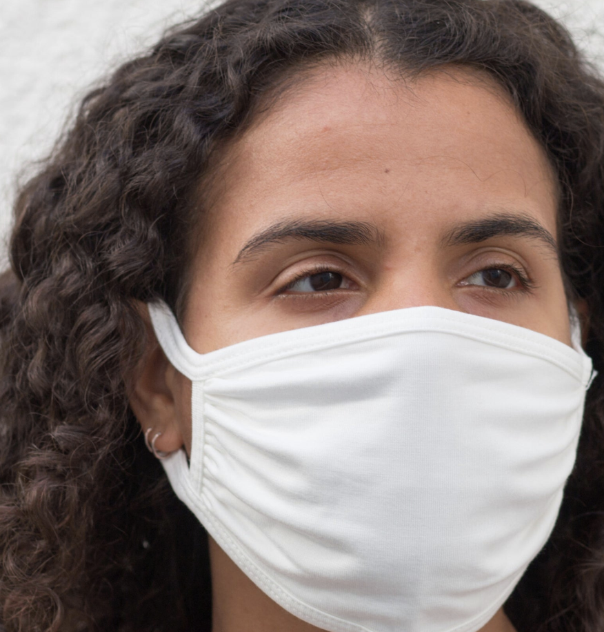A model in a white face mask