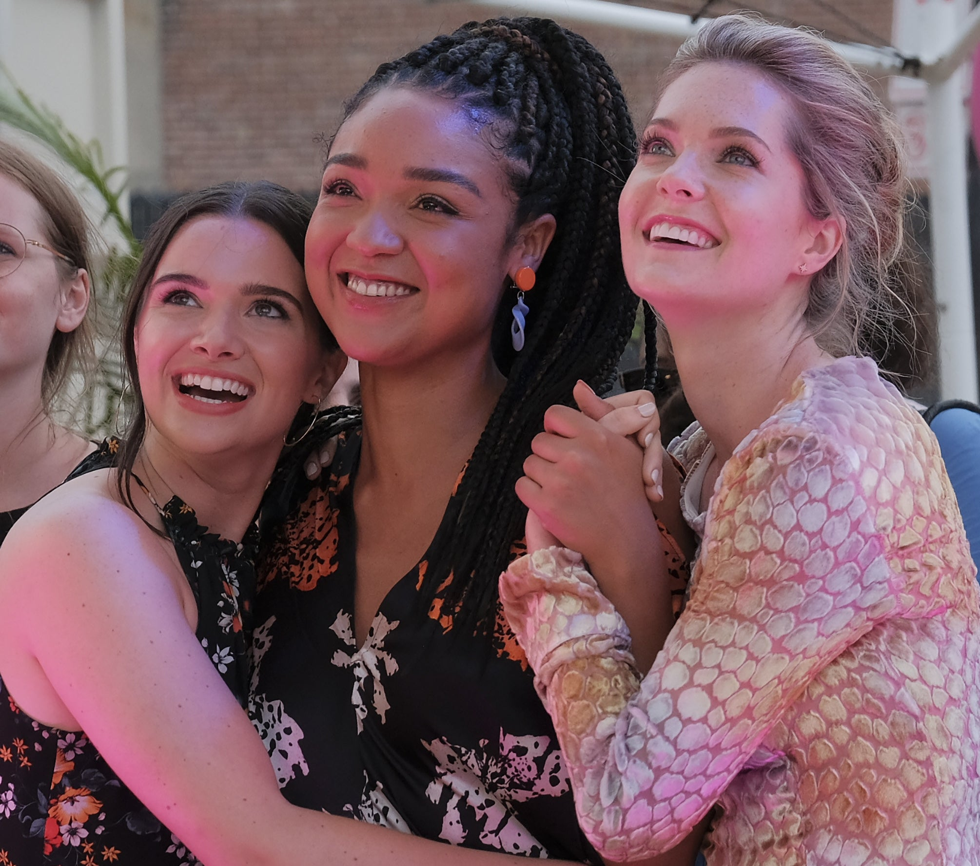 "A scene from ""The Bold Type"" featuring Aisha Dee, Katie Stevens, and Meghann Fahy."