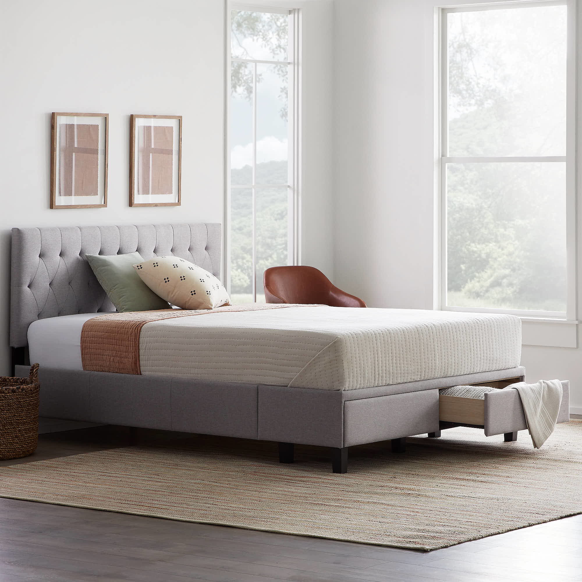 the gray upholstered storage bed