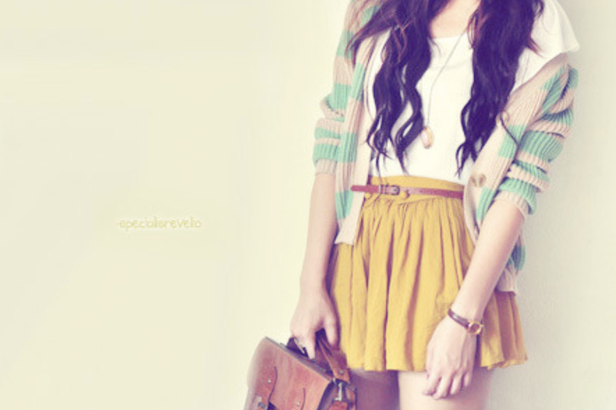 Image of girl in yellow skirt and cardigan
