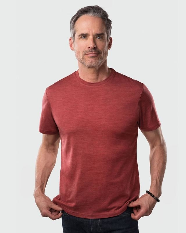 person wearing soft red short sleeve T-shirt that has no wrinkles