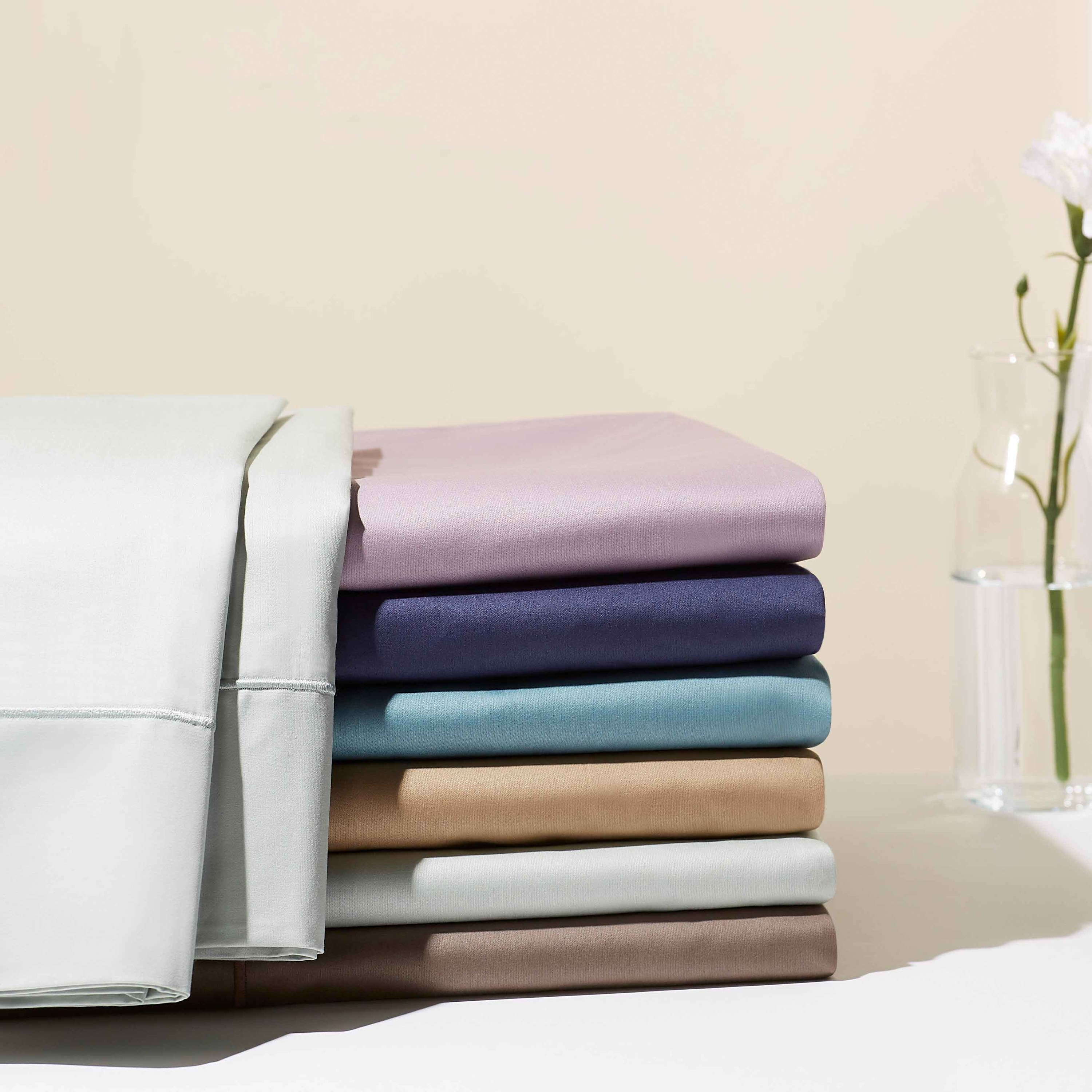 seven of the sheet sets in different colors