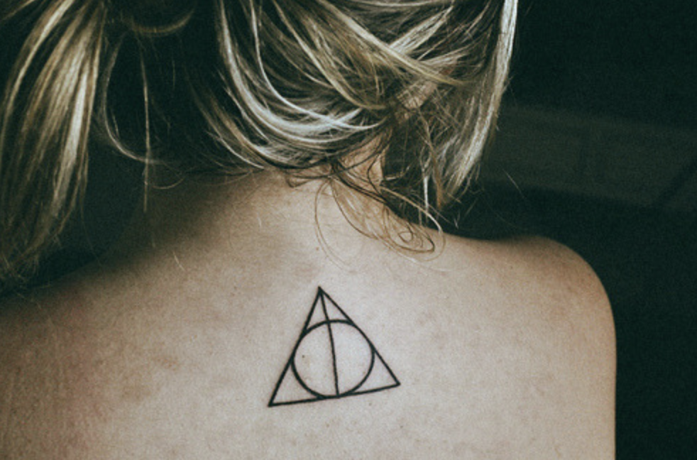 Deathly hallows tattoo on girl's back